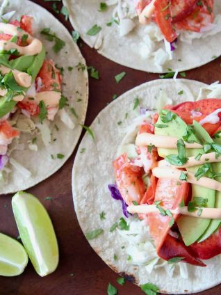 Overhead image of lobster tacos topped with remoulade sauce