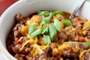 Gluten free chili in bowl with diced green onions