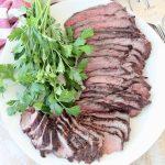 Sliced grilled tri tip steak on plate