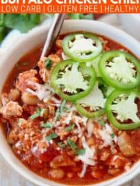 Overhead image of buffalo chicken chili in bowl topped with sliced jalapenos