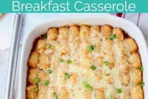 Tater tot breakfast casserole in baking dish with red spatula