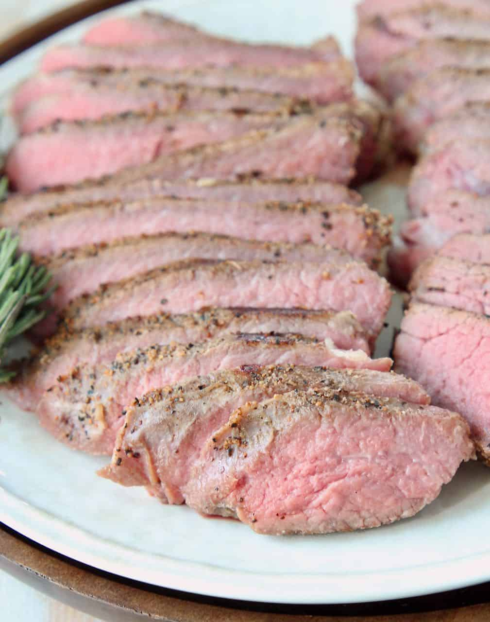 Sliced sous vide tri tip steak on plate