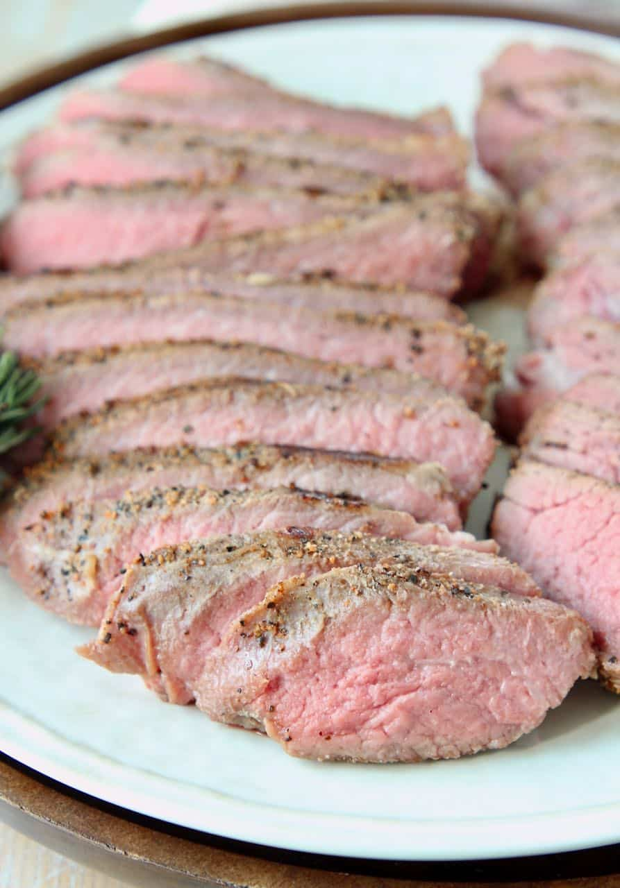 Sliced tri tip steak on plate