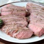 Sliced sous vide tri tip on white plate