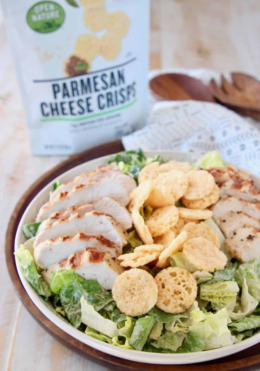 Caesar salad in bowl topped with parmesan cheese crisps