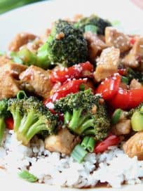 Teriyaki chicken and broccoli over rice on plate