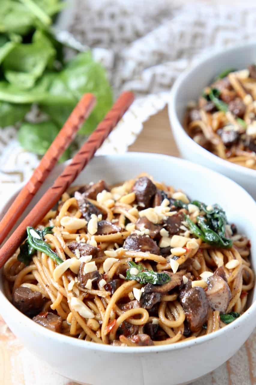 Dan dan noodles in bowl with chopsticks on the side