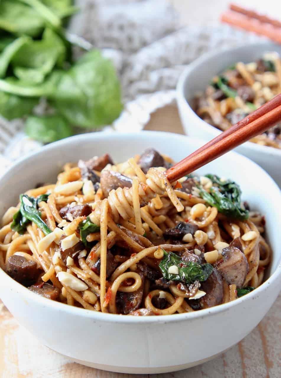 Chopsticks spinning noodles in bowl