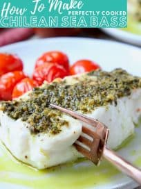 Image of cooked sea bass, topped with pesto, with text overlay