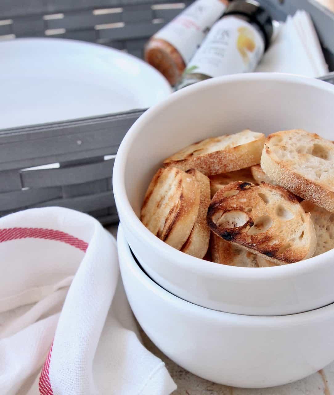 Grilled baguette slices in bowl