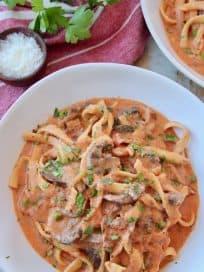 Pasta in creamy tomato sauce in bowl