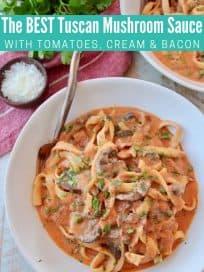 Pasta in creamy tomato mushroom sauce in bowl with fork