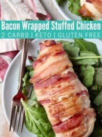 Bacon wrapped chicken breast on plate with fork and salad