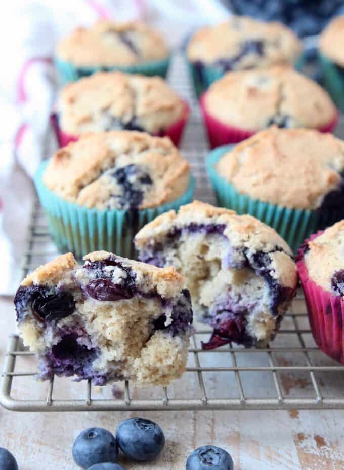 Blueberry muffin cut in half on wire baking rack