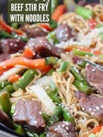 beef stir fry with noodles in skillet