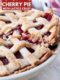 slice of cherry pie lifted out of pie plate