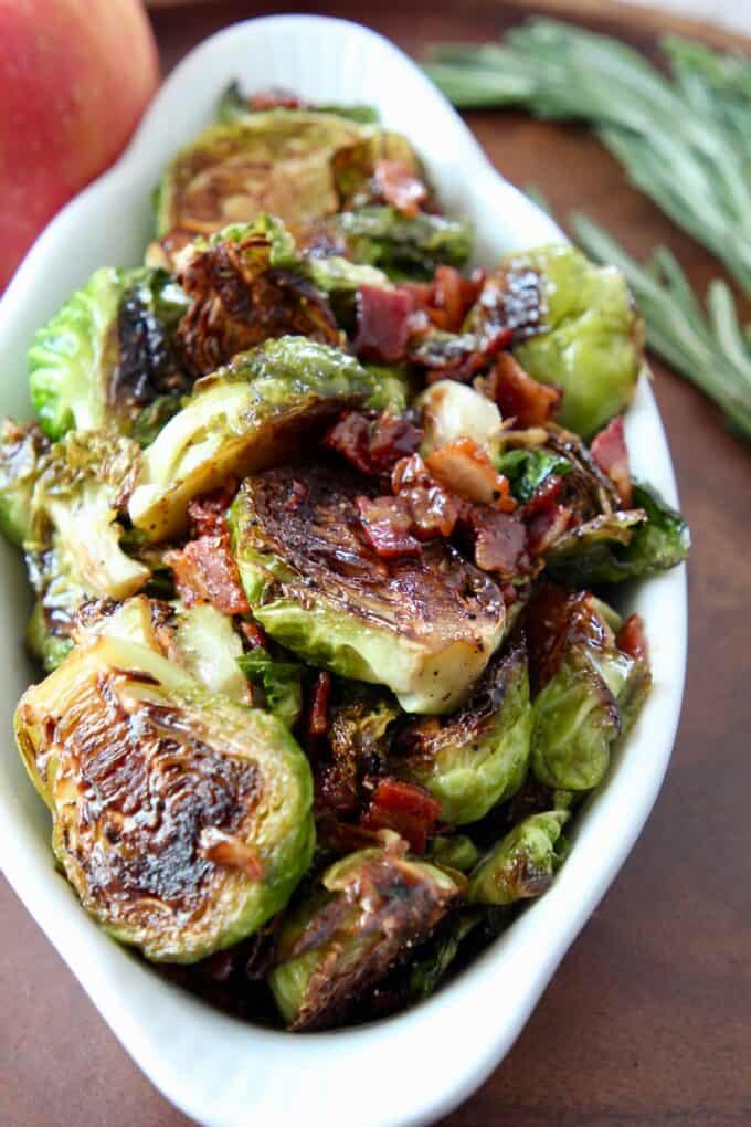 cooked brussels sprouts in dish with cooked bacon