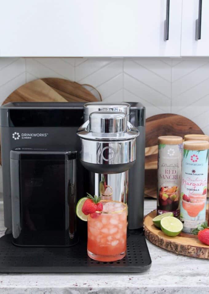 strawberry margarita in glass sitting on Drinkworks home bar appliance