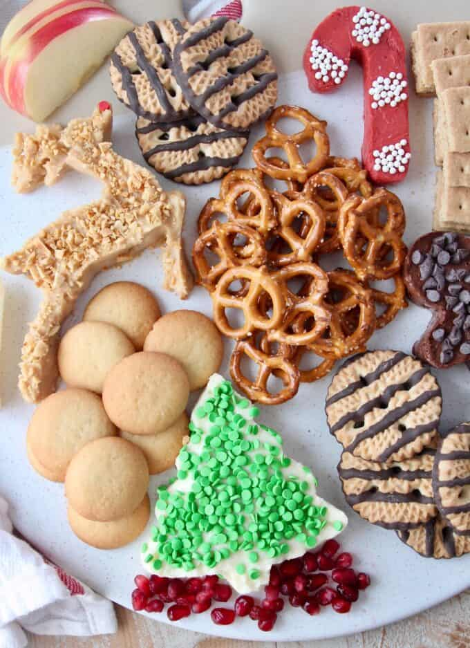 Overhead image of holiday dessert board with pretzels and cookies
