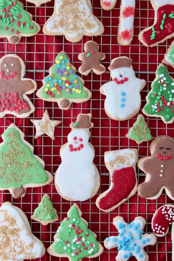 overhead image of decorated sugar cookies on metal baking rack