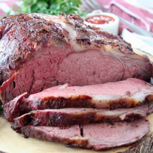 Sliced prime rib on wood cutting board