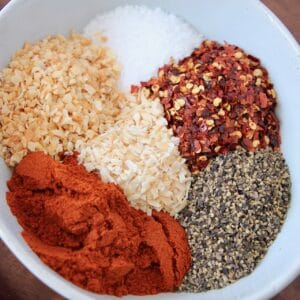 overhead image of spices in white bowl