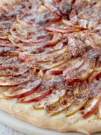 sliced apples on pizza with cinnamon streusel topping
