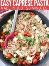 caprese pasta in skillet with red serving spoon